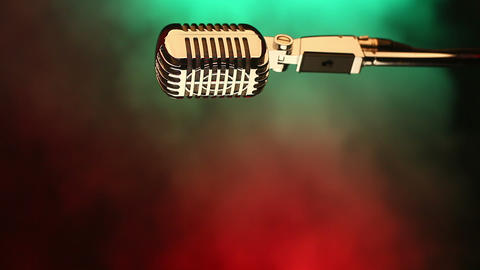 Retro microphone on red and green Footage