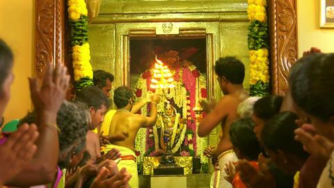 Backside view close up Hindu people praying at hinduism temple / close up Hindu people praying at Live Action