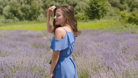 Joyful woman flicking hair in the air in nature Footage