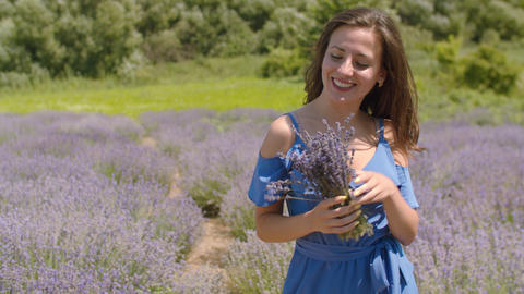 Carefree woman enjoying life in lavender field Footage