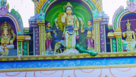 Exterior of Hindu temple shrine ancient historical architecture, A Statue of Lord Murugan the Hindu Live Action