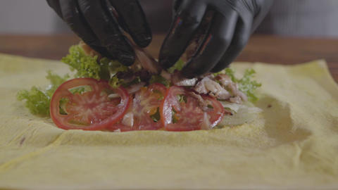 Hands of the chef in black kitchen gloves making shawarma close-up. Tasty arab Footage