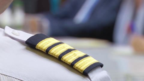The aircraft commander is sitting at a meeting to discuss the business plan for aircraft and flights Footage