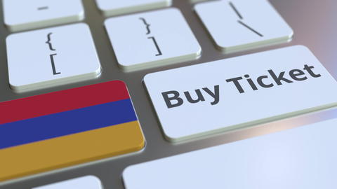 BUY TICKET text and flag of Armenia on the buttons on the computer keyboard Photo