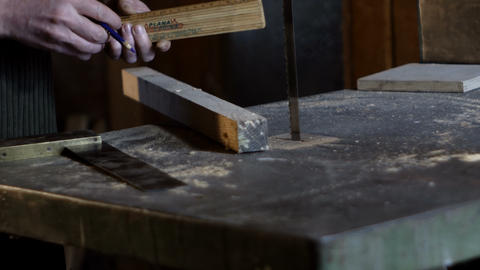 Carpenter measures and marks cutting line using a carpenter's ruler Footage