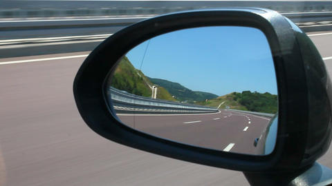 Highway view during cruising in vehicle rear view mirror Live Action