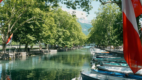 view on boats and flags at the lake in Annecy, France Footage