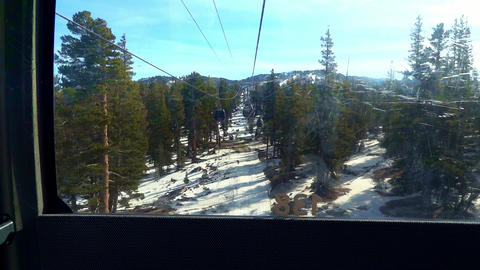 Point of View from inside a Heavenly cabin lift going up a snowy mountain on a ski resort 25th Dec Live Action