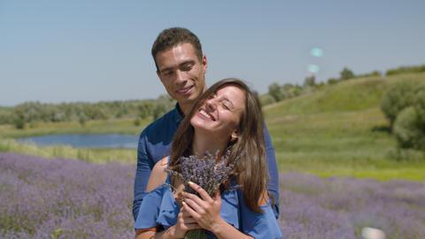 Pretty woman enjoying fragrant lavender blossoms Live Action