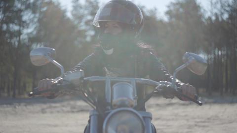 Portrait pretty girl wearing black helmet sitting on the motorcycle looking away Footage