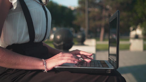 Female hands typing text on a laptop, side view. The woman is angry of work and Footage