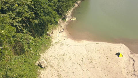Aerial view tourist people on camping at river shore while summer vacation Footage