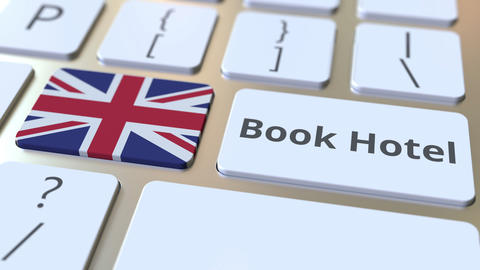 BOOK HOTEL text and flag of Great Britain on the buttons on the computer Live Action