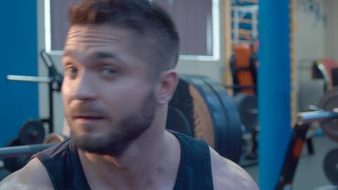 Portrait of bodybuilder telling something Footage