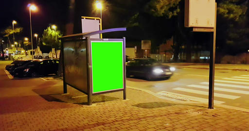 billboard with a chroma key green screen on a traffic cars city night street, light night Live Action