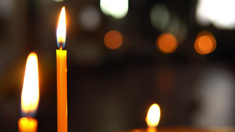 Large burning candle in close-up focus Footage