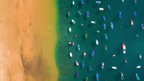 Aerial view of the golden sand of the beach Las Teresitas and colorful boats Footage
