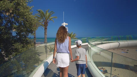 Happy family outdoors. mother and son walk near the sea Footage