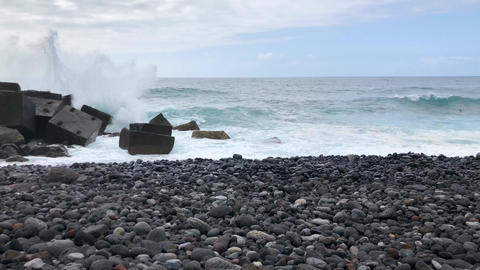 Timelapse of a large pebble beach and ocean waves reaching shore. Rocky shore of Live Action