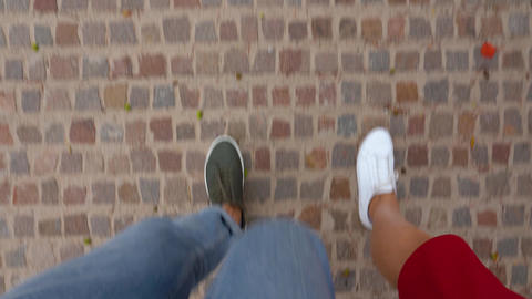 Top view of male and female legs go through a pedestrian crossing Footage