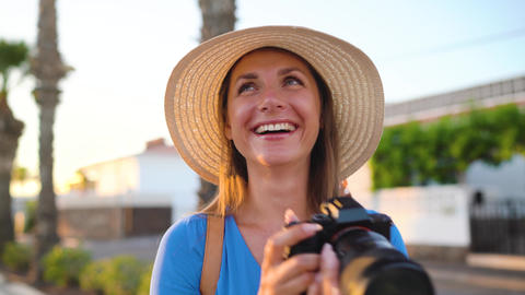 Photographer tourist woman taking photos with camera in a beautiful tropical Footage