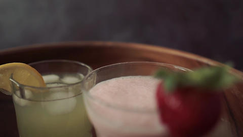 Close-up of various juices and smoothies. Strawberry milkshake and lemonade Live Action