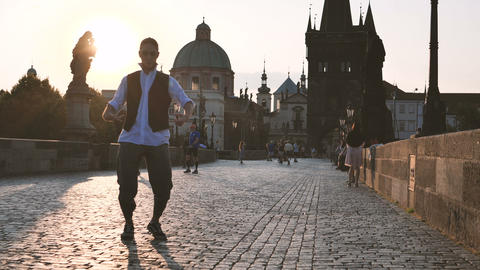 4k - The boy dancing krump on the Charles Bridge with sunshine, slow motion Live Action