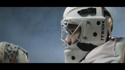 goalie in mask and gloves stands at gate ready for attack Live Action
