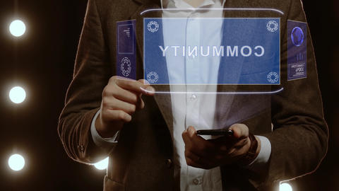 Businessman shows hologram with text Community Footage