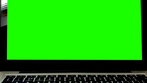 Modern laptop with Green Screen on black Background Animation