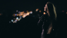 Woman enjoying night city from observation deck Footage