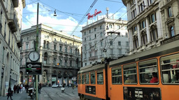 "Europe Italy Lombardy Region Milan 012 trams in street "" Via Orefici "" behin Footage"
