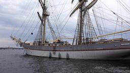 Approach elegant sailing ship, anchored at Neva river, tilt up to masts Footage