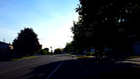 City Suburb Intersection Traffic in Summer. Urban Landscape With Car Vehicles Driving Through Road Footage