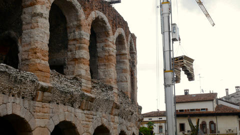 Arena di Verona, with cranes while setting up a scene inside, a destination for Footage