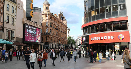 Crowd Of People Walking On City Street At Leicester Square GIF