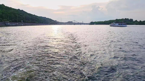 4K, the ship sails on the wide river of the Dnieper with large bridges before Footage