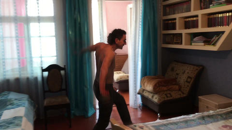 man falling jumping on bed happy relaxing trying to sleep, party time, vacation Footage
