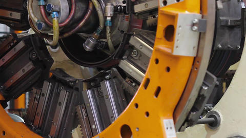 Tire manufacture robotic machine close up Live Action