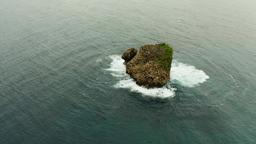 Rocky island in the ocean Footage