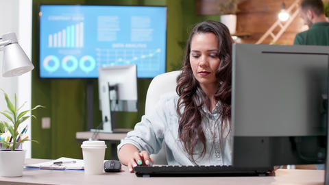 Revealing shot of woman working in cozy office Footage