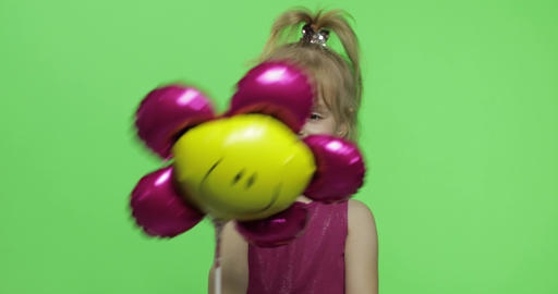 Girl holds balloon in the form of flower. Happy four years old girl. Chroma Key Live Action