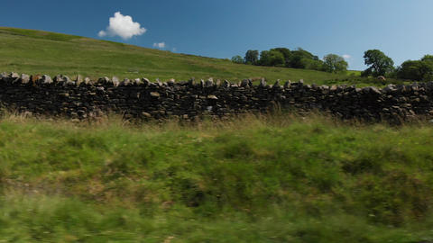 A Dolly styles shot of a single-track road and grass verge 5 (V352) Live Action