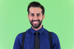 Face of young happy bearded Persian businessman smiling Photo