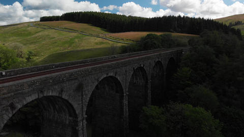 Aerial shot of the Dent Head Viaduct descending into the shadows (V405) Footage