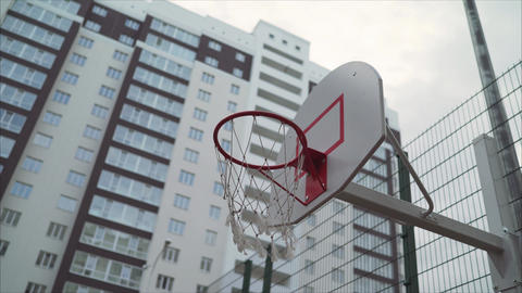 basketball ring in the courtyard of a multi-storey building. A new basketball Footage