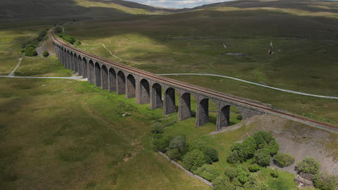 Aerial shot pulling back from the Ribblehead Viaduct (V409) Live Action
