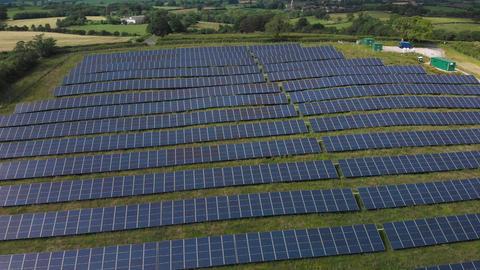 Flying over solar panels (V443) Live Action