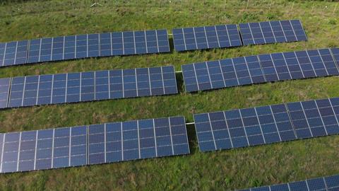 A pullback over solar panels (V444) Live Action