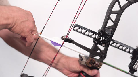 Close up shot of pro archer shooting arrow with mechanic bow Live Action